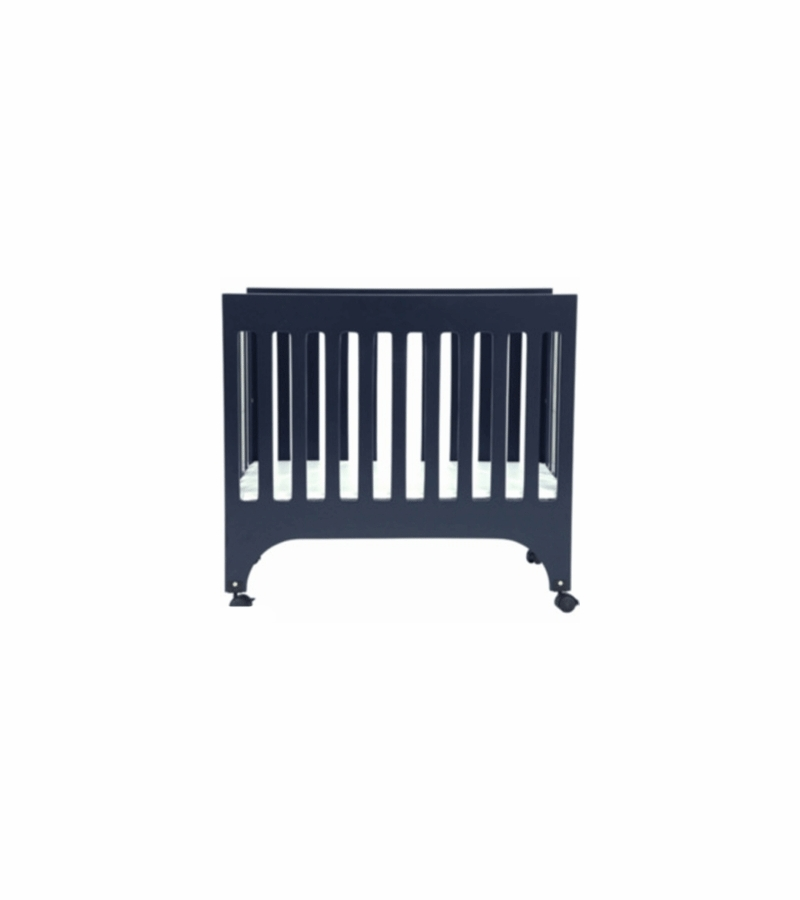babyletto grayson mini crib in navy with pad