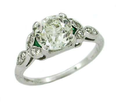 Antique 1.60 Carat Old Mine Cut Diamond and Side Emerald Platinum Engagement Ring