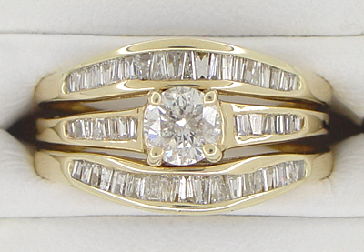 Estate Baguettes Diamond Engagement Ring and Double Hugger Wedding Set in 14 Karat Gold
