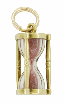 Hour Glass Charm with Pink Sand in 14 Karat Gold - Item C595 - Image 1