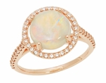 Natural Translucent Opal Halo Ring in 14 Karat Rose Gold with Diamonds