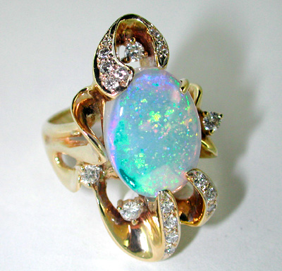 White Opal Ring set with Diamonds in 14 Karat Gold