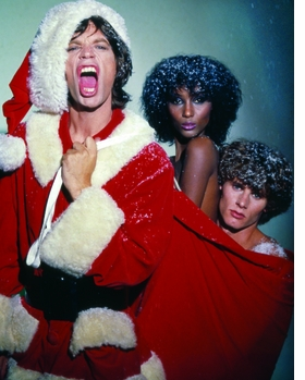 """Photographer Ara Gallant�s dazzling photographs, like this wild holiday portrait of Mick Jagger, supermodel Iman, and model/photographer Paul Van Ravenstein from 1977, were truly a reflection of his personality. In her introduction to <a href=""""http://www.artbook.com/9788862081207.html"""">Ara Gallant</a>, Anjelica Houston explains, """"When Ara danced, we girls followed. He was in his element and so were we. He could pivot two six-foot models in Manolo�s with the greatest of ease. He could transform a dance floor, make a room crackle, turn the lights down low."""" <p>From all of us at DAP and ARTBOOK, we wish you Merry Christmas and a Happy New Year!"""