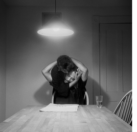 <I>Untitled (Man reading newspaper)</I> (1990) is reproduced from <I>Carrie Mae Weems: Kitchen Table Series</I>.