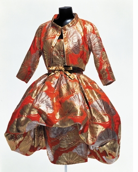 "Featured image, reproduced from <a href=""http://www.artbook.com/9782854952650.html"">Christian Dior: Man of the Century</a>, is <i>Orange rayon bolero jacket and cocktail dress embroidered with gold and silver dacron pine motifs, incorporating brassiere, designed by Daimaru exculsively for Japan under the Christian Dior label, circa 1958</i>, from the Kyoto Costume Institute."