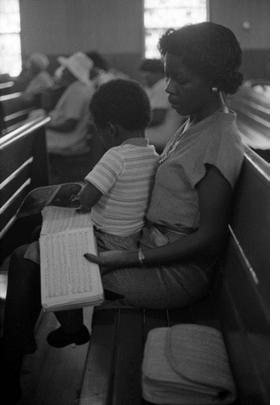 """Featured photograph, """"Sacred Harp singing at Speights and Hoover Day, Campbellton, Florida, 1980,"""" is reproduced from <I>Drop on Down in Florida.</I>."""