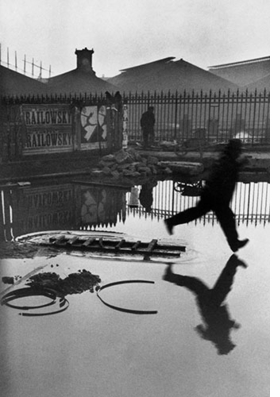 """Place de l'Europe, Paris,"" 1932, is reproduced from <I>Henri Cartier-Bresson: The Decisive Moment</I>."