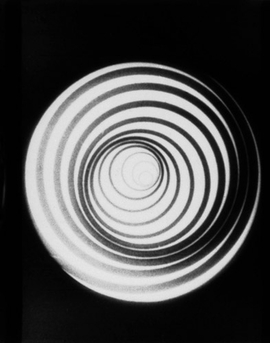Featured image, a still from Marcel Duchamp's film <I>Anemic Cinema</I> (made under the name Rrose Sélavy), is reproduced from <I>Inventing Abstraction, 1910-1925</I>.