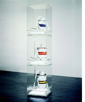 "Featured image, reproduced from <I>Jeff Koons</I>, is one of the vacuum cleaner works from <I>The New</I> series of the 1980s. In 1987, Koons was quoted in <I>Flash Art</I>: ""In the beginning the work was viewed in relation to consumerism. The sociopolitical dialogue that people have with objects was treated in a very light manner, almost always without reference to its tragic side. And my work is very involved with the tragedy of unachievable states of being. The only way the work could be judged critically would be in light of the increasing reality of the desire to attain these unachievable states. My work has always pursued perfection, which is unachievable; nevertheless, it has continued in its tragic quest."""