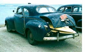 "Featured image, captioned ""In 1957, $35.00 purchased John's Chrysler rig, 'Black Beauty,'"" is reproduced from <I>John Severson's SURF</I>."
