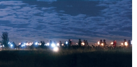 """Featured image, reproduced from <I>Redesigning Wounded Landscapes</I>, is captioned """"'Off to new shores! An almost utopian light and sound sculpture:' Thousands of torches formed a chain of light."""""""