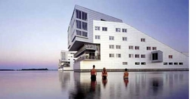 """Featured image, of """"De Sphinxen""""--five residential blocks in the water of the Gooimeer lake, Huizen, designed by Neutelings Riedijk Architects--is reproduced from <I>Sweet & Salt</I>."""
