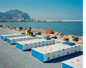 """Featured Wim Wenders photograph, <i>Sun Bather, Palermo</i>, is accompanied by text from the artist: <i>""""'Nothing exists without its opposite.' (Who the heck said that?) But what could the opposite of this be? And where would it exist? I couldn�t help thinking that this 'beach scene' in Palermo was already part of a parallel world.""""</i>"""