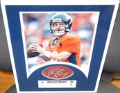 Peyton Manning autographed NFL football swatch matted & framed with Denver Broncos 8x10 photo UDA