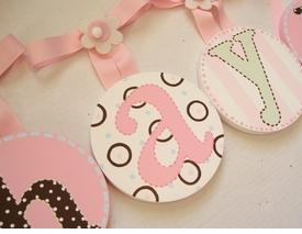 hand painted round wall letters - light pink, brown, green