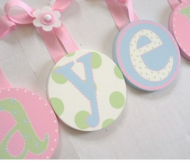 hand painted round wall letters - pink blue green