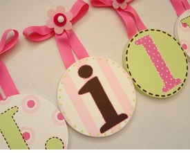 hand painted round wall letters - pink, brown and green