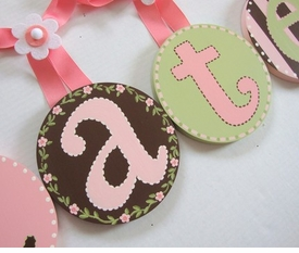hand painted round wall letters - pink brown green