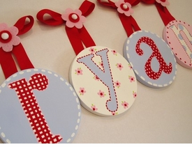 hand painted round wall letters - red with light blue
