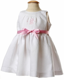 infant pique dress with pickstiched grosgrain ribbon