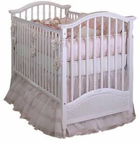 madison spindle crib with caning and applique