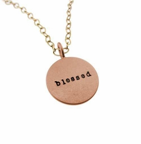 rose gold charm with yellow gold chain