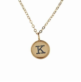 solid gold charm with raised edge