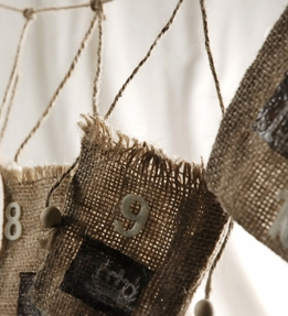 "Burlap Bags Numbered (1-24) on a 103"" Cord"
