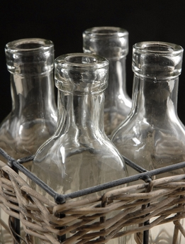 Glass Bottles in Willow Basket