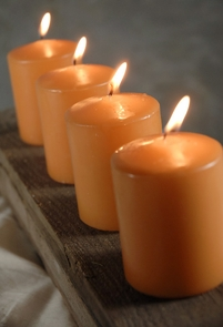 "Light Orange/ Caramel Unscented 3"" Candles (4 candles) 25 hr. burn"