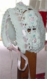 Crocheted Baby Bonnet, White Hand Knit With Pink Ribbon.