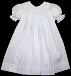 Girl's Smocked Dress in White With Pearls By Petit Ami.