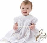 Girl's Smocked Dress in White with White Pearls By Royal Child.