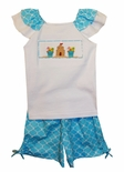Vive La Fete Girl's Turquoise Quatrefoil Shorts and Trimmed Smocked Shirt with Sand Pails and Sand Castle