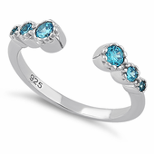 Sterling Silver Six Round Cut Blue Topaz CZ Ring