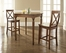 3-Piece Pub Dining Set with Turned Leg and X-Back Stools in Classic Cherry Finish - Crosley Furniture - KD320009CH