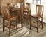 5-Piece Pub Dining Set with Tapered Leg and School House Stools in Classic Cherry Finish - Crosley Furniture - KD520007CH