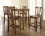 5-Piece Pub Dining Set with Turned Leg and School House Stools in Classic Cherry Finish - Crosley Furniture - KD520011CH