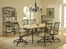 Brookside 7-Piece Rectangle Dining Set with Oval Back Caster Chairs in Brown Powder Coat - Hillsdale Furniture - 4815DTBCOVC7