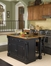 Monarch Kitchen Island with Granite Top and Two Bar Stools in Black / Oak - Home Styles - 5009-948