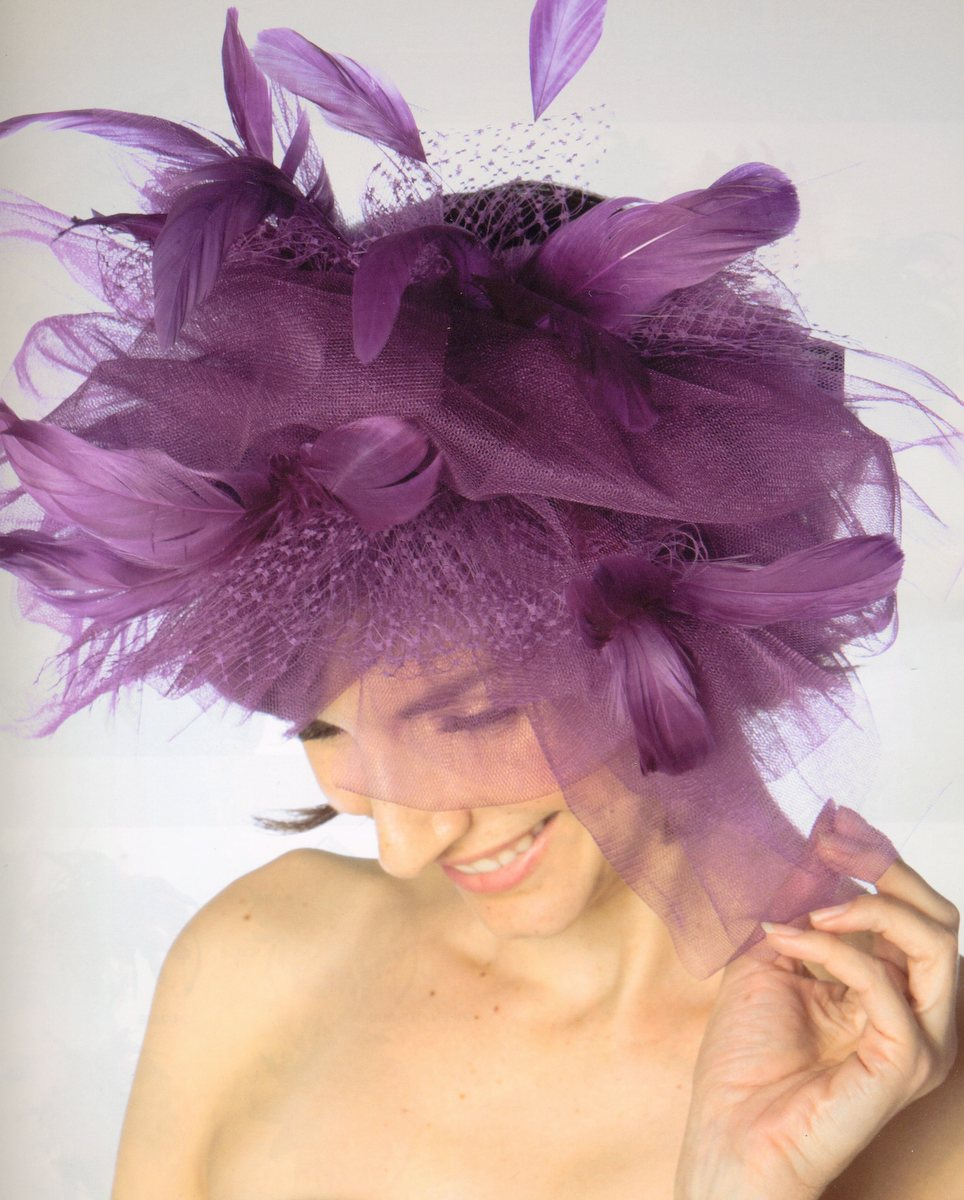 large fascinator a dramatic hat with feathers tulle