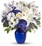 White flower with blue vase