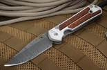 Chris Reeve Large Sebenza 21 Snakewood and Ladder Damascus
