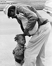 African American Man w/ Crying Child Candid Photo Print for Sale