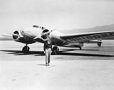 Amelia Earhart with her Lockheed Electra Photo Print for Sale
