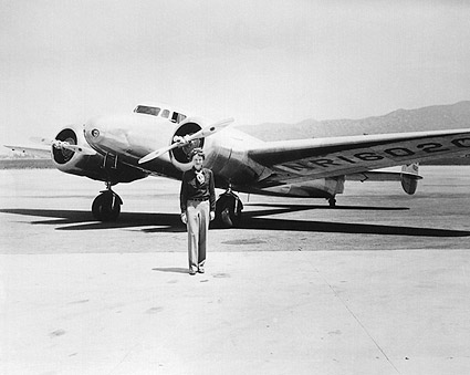 Amelia Earhart with her Lockheed Electra Photo Print