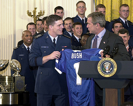 George W. Bush Presented w/ Football Jersey Photo Print
