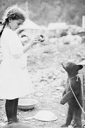 Girl Teasing Bear Cub w/ Doughnut Photo Print