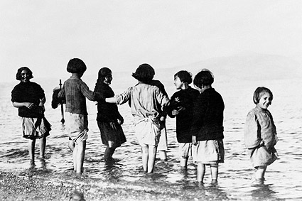 Greek Orphan Children Play in Mediterranean Photo Print