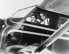 Howard Hughes & Nancy Carroll in Airplane Photo Print for Sale